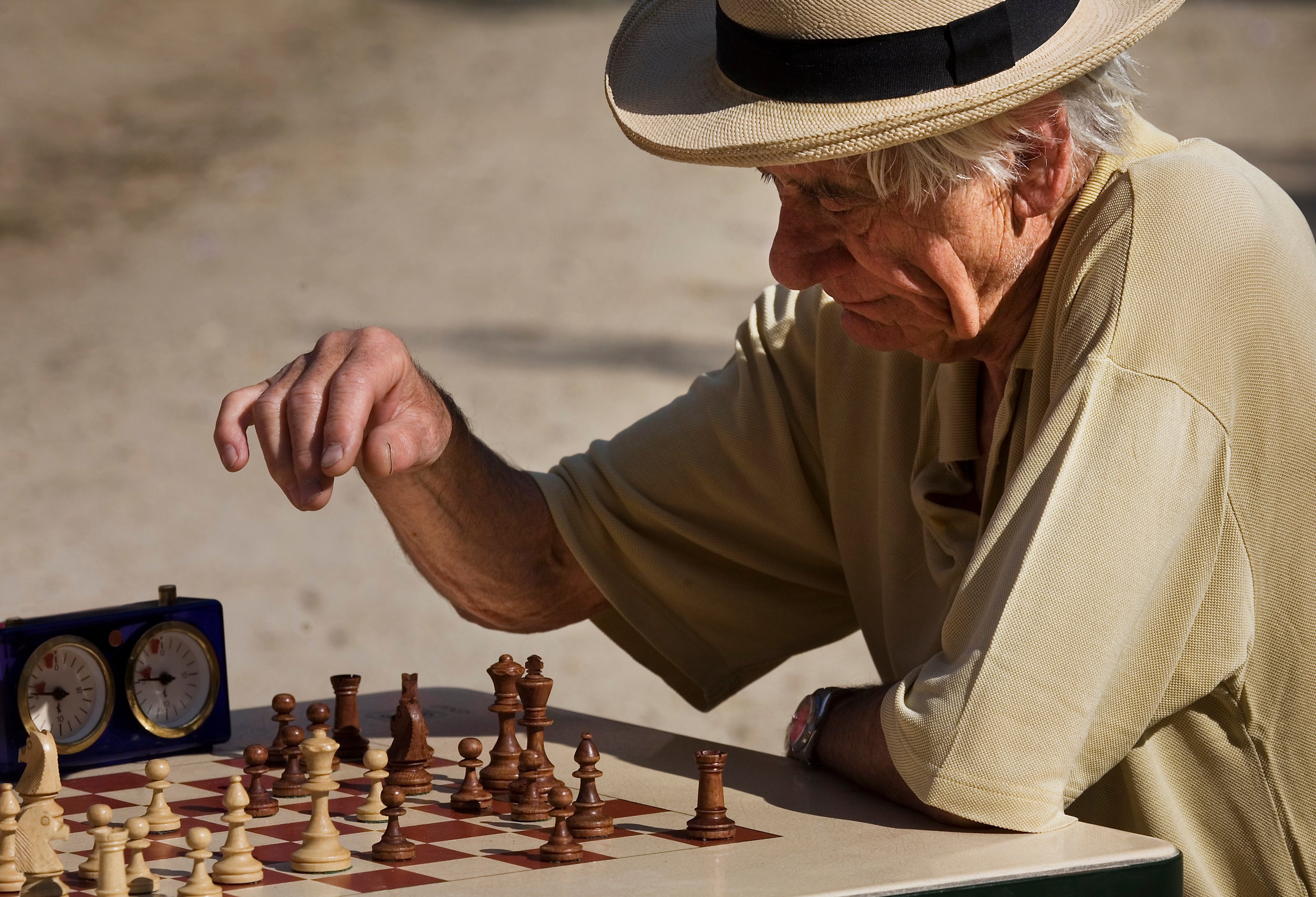 old person playing chess.jpg