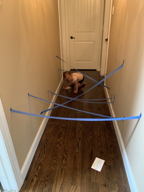 Indoor Obstacle Course - Crawling Under Tape