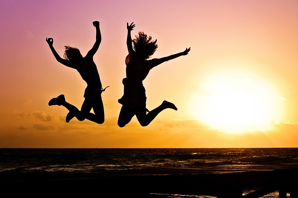 Jump-Sunrise-Two-Happy-Active-Youth-Silhouettes-570881.jpg